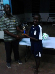 Captain of Carl Brown accepting the winning trophy