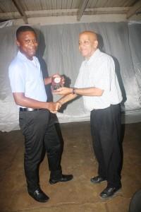 Romario Hall receiving his award